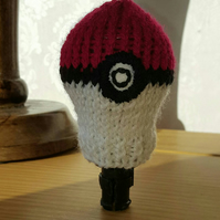 a hand knitted gear knob beanie hat in choice of pokemon ball designs