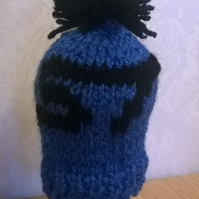 a hand knitted gear knob beanie hat for ford with ST logo design