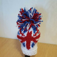 a hand knitted gear knob beanie hat with union jack heart logo
