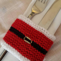 5 piece set of hand knitted santa wine bottle cover and 4 cutlery sleeves