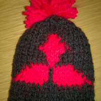 a hand knitted gear knob beanie hat cover with fun mitsubishi design