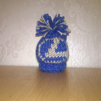a hand knitted gear knob beanie hat cover with fun lexus design