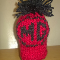 a hand knitted gear knob beanie hat cover with fun MG design