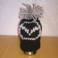 a hand knitted gear knob beanie hat cover with fun mazda design
