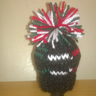 a hand knitted gear knob beanie hat cover with fun fiat 500 design
