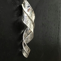 Handmade Sterling Silver food formed twist pendant