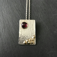 Hand made Sterling Silver and Garnet pendant