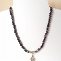 Snowflake obsidian man's necklace with leaf pendant