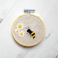 Daisies and a bee wall art