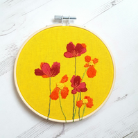 Red flowers on yellow embroidery art