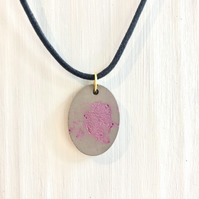 Oval polished concrete pendant necklace, dark pink