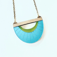 Clamshell etched acrylic necklace. Light blue and apple green with walnut wood.