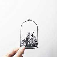 Papercut of a belljar