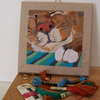 hand embroidered picture of a cat