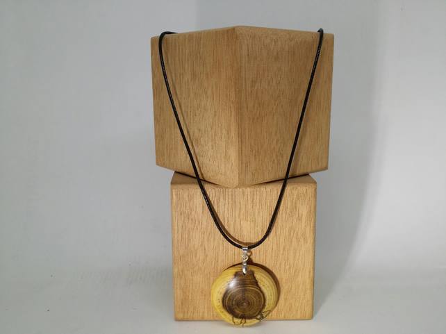 wood pendant turned from laburnum