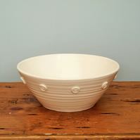 White satin glazed bowl with embossed spiral motifs (Back left)