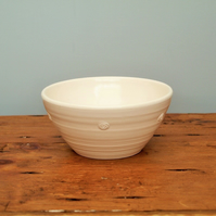 White satin glazed bowl with embossed spiral motif (Back right)