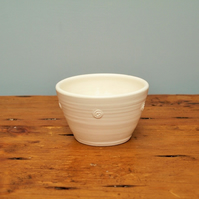 Small white satin glazed bowl with embossed spiral motif