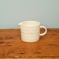 Small white satin glazed jug