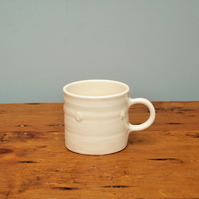 White satin glazed mug with embossed spiral motif