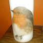 Hand decorated white medium pillar candle with majestic robin