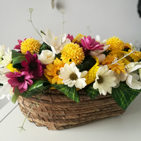 Artificial silk yellow, white, purple flowers brown wicker basket arrangement