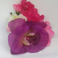 Fake hair flower in pink white and purple
