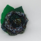 Crochet blue and green flower brooch