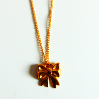 Gold Bow Pendant