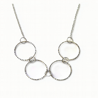 Serrated Face Linked Rings Necklace