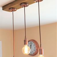Industrial ceiling light fitting with timber base and 3 copper pendants
