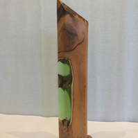 Yew wood sculpture with green resin