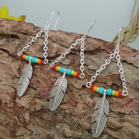 Rainbow feather earrings, a pair and a spare, colourful dreams