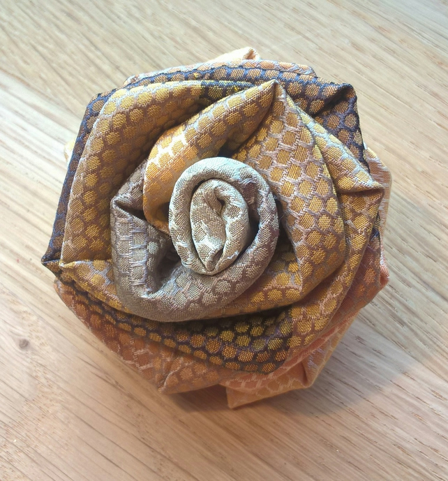Unique up cycled tie rose brooch with honey comb patterned fabric