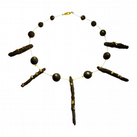 Back to the Tribal Range: Black Gold Stoneware Necklace by Cresta Ceramics