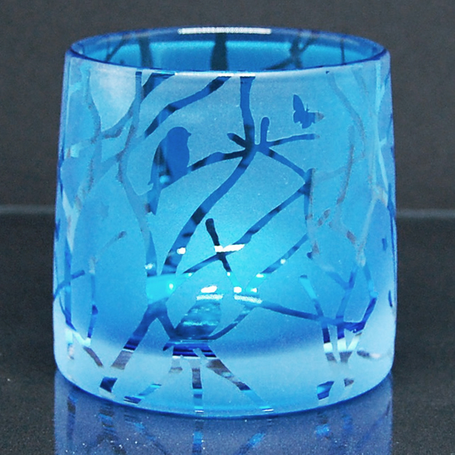 Blue tealight holder with sandblasted twigs, birds and stars design