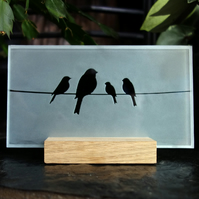 Freestanding sandblasted glass with clear birds design