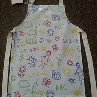 Child's Wipeable Scribbling detail Oil Cloth Apron - Age 5-6 years