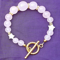 Beautiful Rose Quartz bracelet with stars.