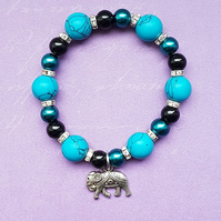 Turquoise beaded stretch bracelet with Elephant charm