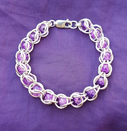 Captive bead bracelet with purple beads
