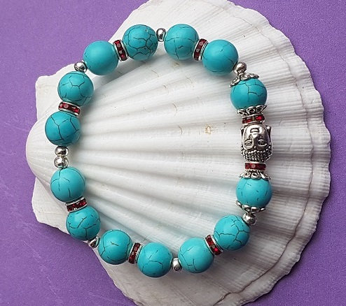 Beautiful Turquoise and Siam Buddha head stretch Bracelet
