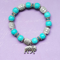 Beautiful Turquoise and fancy bead stretch bracelet with Elephant charm