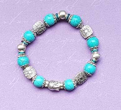 Beautiful Turquoise and fancy bead stretch bracelet with Buddha head.