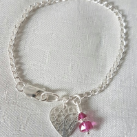 Gorgeous Sterling Silver bracelet with Swarovski crystals in Fuchsia Pink.