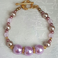 Elegant Pink and gold tones Bracelet with Rose Quartz beads.