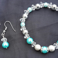 Gorgeous Icy blue stretch bracelet and earring set