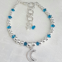 Gorgeous Silver bead and Dark Aqua Crystal bracelet with Crescent Moon