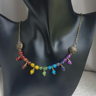 Beautiful Bronze tone Trio bead Rainbow necklace.
