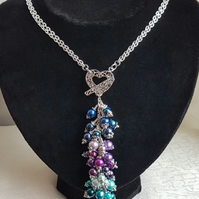 Gorgeous Majestic Peacock Bead Dangle Necklace - Silver tones